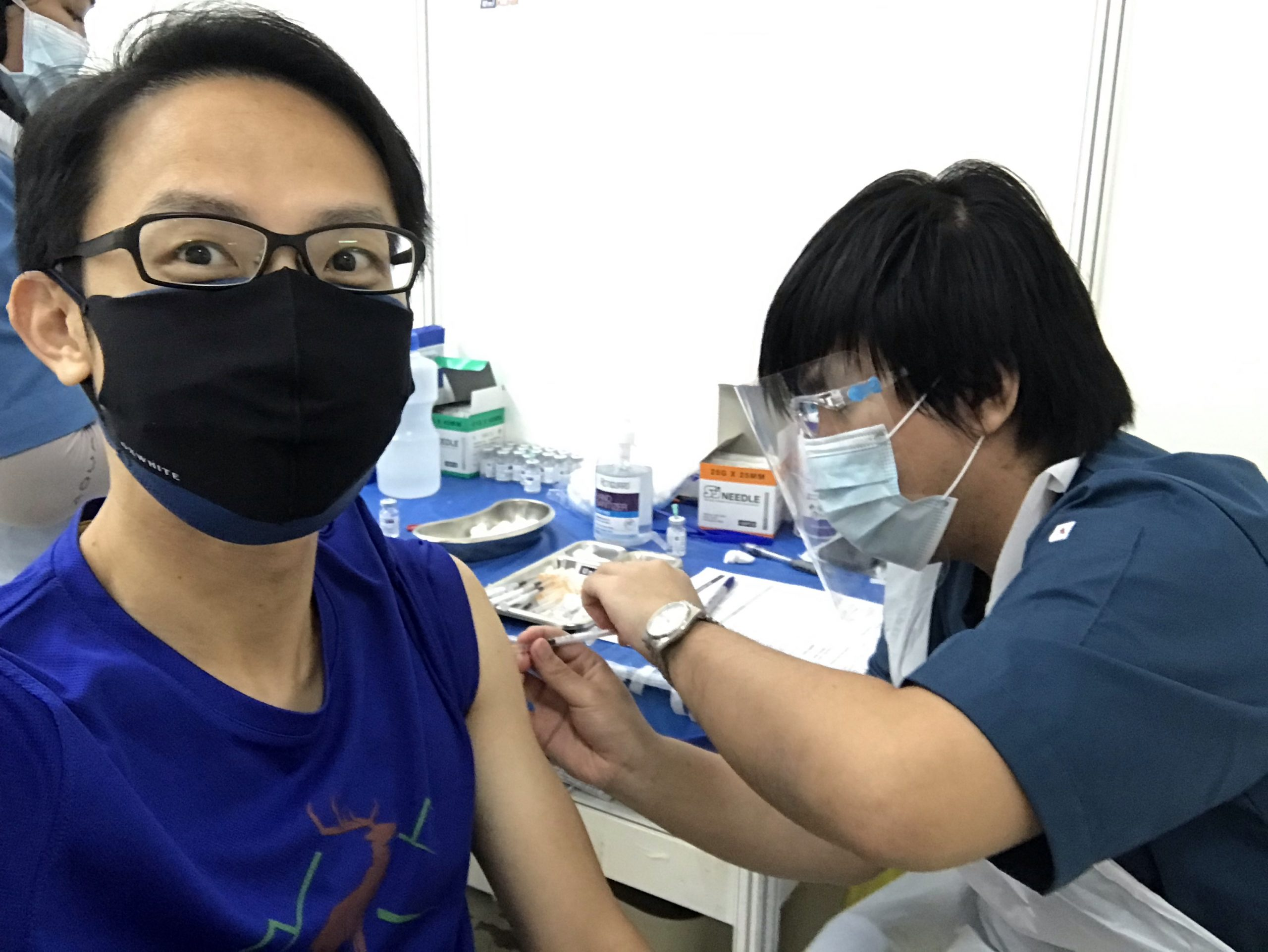 Taking my first jab, it was fast and painless.