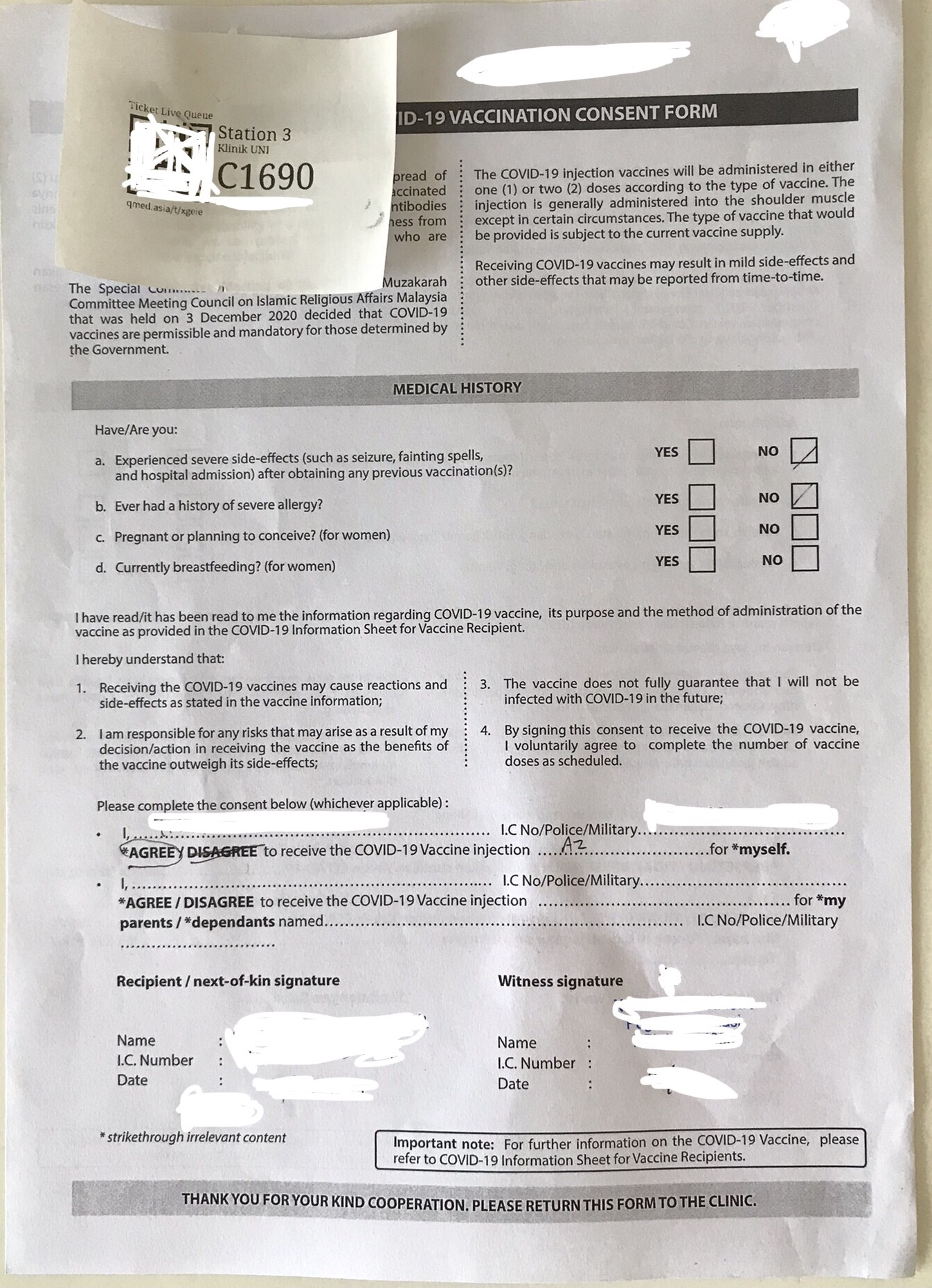 The vaccination consent form, there are 2 copies, fill up both.
